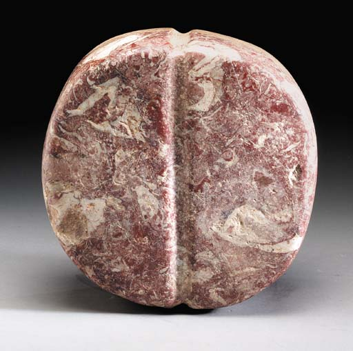 A BACTRIAN VEINED RED STONE RI