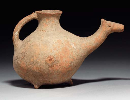 AN IRANIAN POTTERY VESSEL IN T
