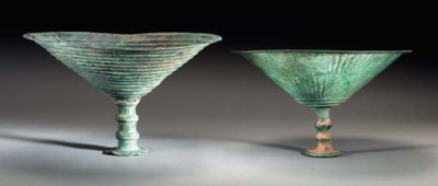 TWO LARGE IRANIAN BRONZE FOOTE