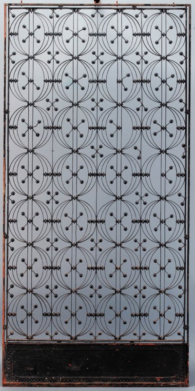 AN IRON ELEVATOR GRILLE