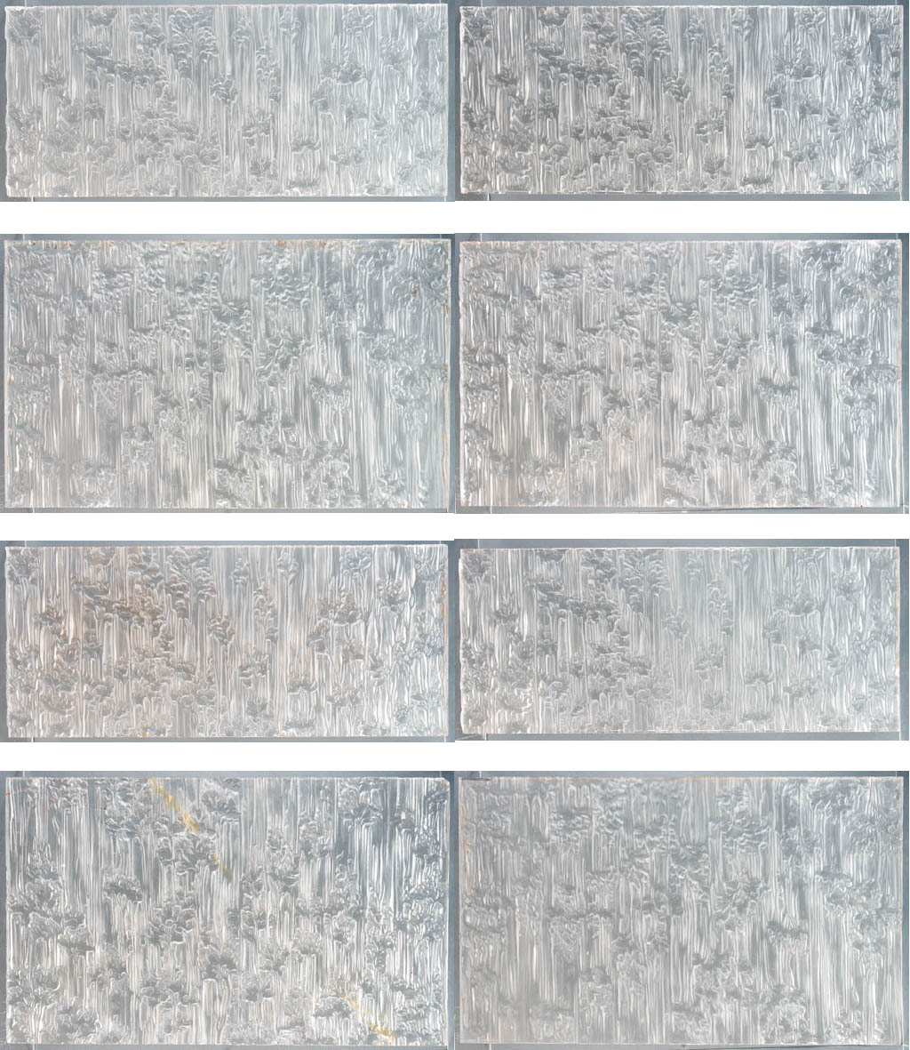 A SET OF EIGHT IMPORTANT MOLDED GLASS PANELS