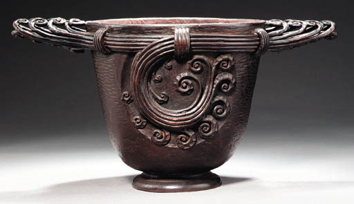 A WROUGHT-IRON URN