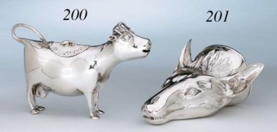 A GEORGE III SILVER COW CREAME