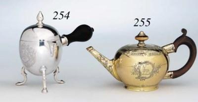 A GEORGE II SILVER-GILT TEA PO