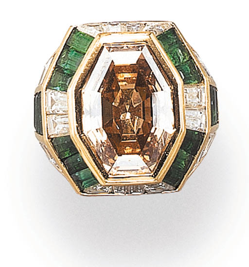 A COLORED DIAMOND, EMERALD AND NEAR-COLORLESS DIAMOND RING