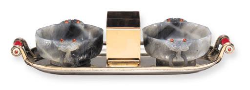 AN ART DECO SILVER AND QUARTZ SMOKER'S COMPENDIUM, BY CARTIER