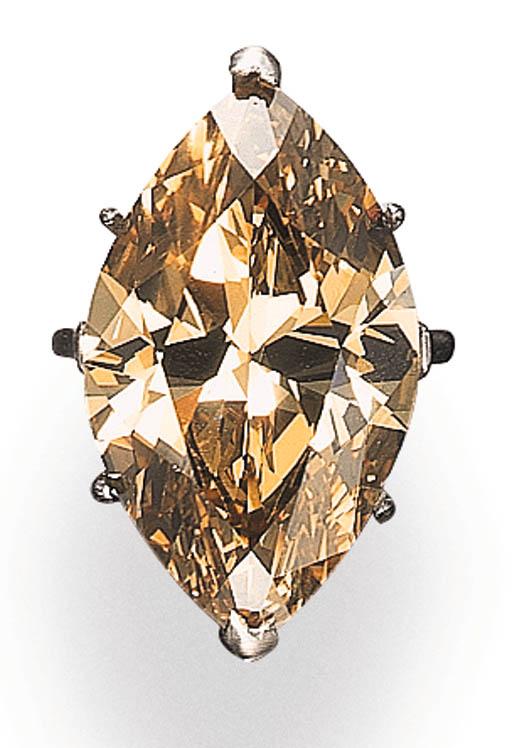 AN IMPRESSIVE SINGLE-STONE FANCY DEEP BROWN-YELLOW DIAMOND RING