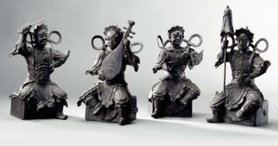A GROUP OF FOUR BRONZE FIGURES