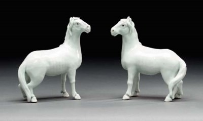 A PAIR OF WHITE-GLAZED FIGURES