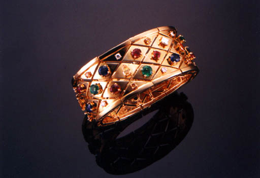 AN 18K GOLD AND MULTI-GEM BANGLE, BY CARTIER