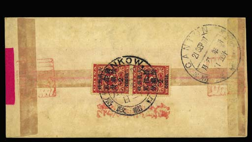 """cover 1897 (8 Sep.) red band cover to Canton bearing, on the reverse, a vertical pair of large figures 2c. on 3c. red tied by a fine strike of the Hankow Dollar chop with Canton Dollar chop alongside, a variety of additional handstamps including """"postage fully paid"""" in red alongside the adhesives. A scarce official cover. Photo"""