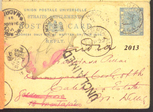 """cover 1891 (July) Straits 3c. card (reply half) from Nibong Tabal to India and redirected, cancelled with a fair to good strike of the circular """"NEBONG/CROWN/TABAL"""" h.s. with Nibong Tabal c.d.s., Penang, Singpaore and Indian c.d.s. on face together with large """"UNCLAIMED"""" h.s., various c.d.s. on reverse; water stain on face though full of character. Photo"""