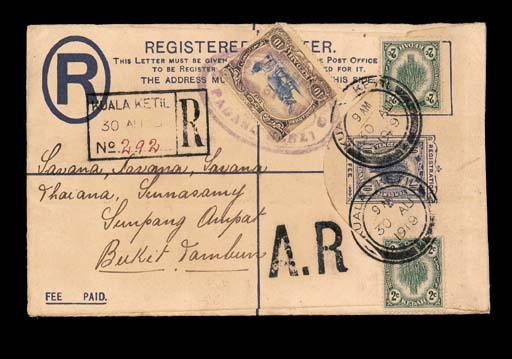 """cover 1919 10c. registered envelope, uprated with 2c. (2), from Kuala Ketil to Bakit Teambun, showing large """"A.R"""" h.s. and additionally bearing 10c. applied in transit and cancelled with Padang Serei oval d.s., Penang and arrival c.d.s. on reverse; unusual and earlier than recorded for this office by both Holley and Proud. Photo"""