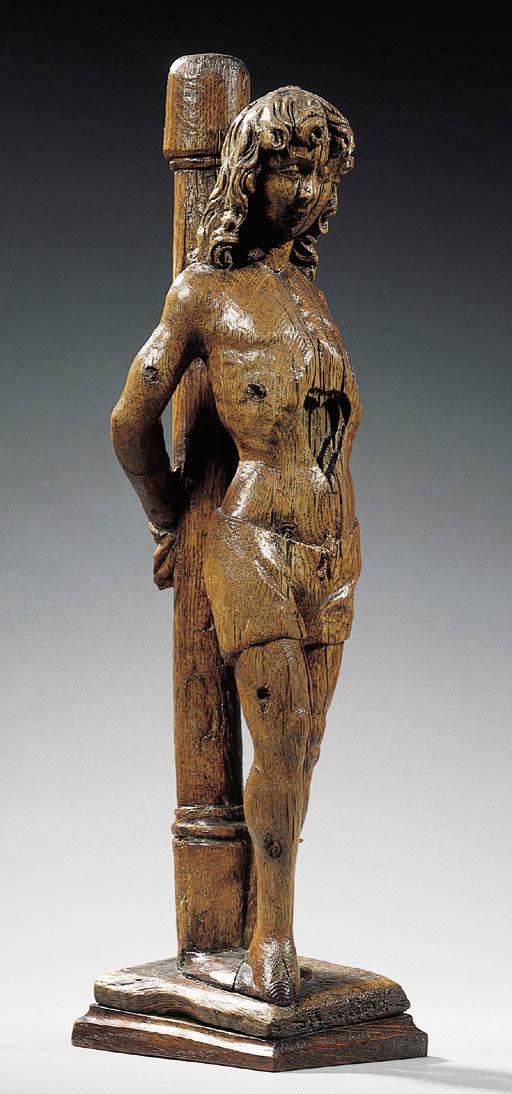 A carved wood figure of St. Se