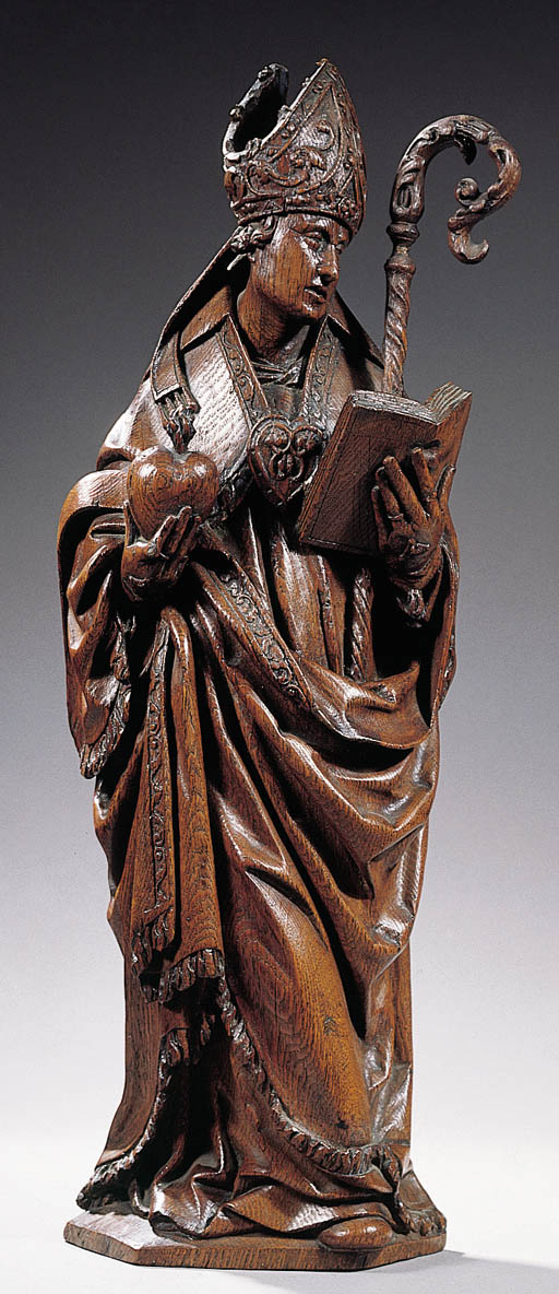 A carved wood figure of a Bish