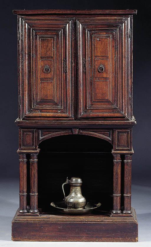 An oak side cabinet on later s