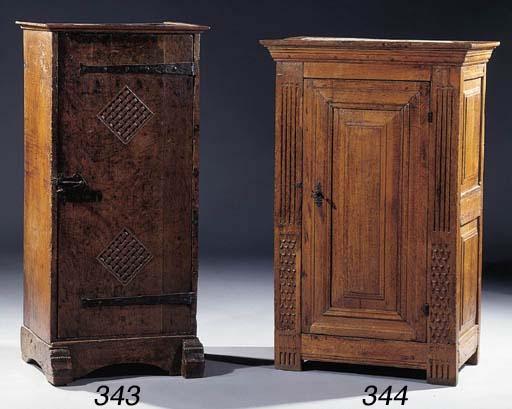 An iron-mounted oak cupboard