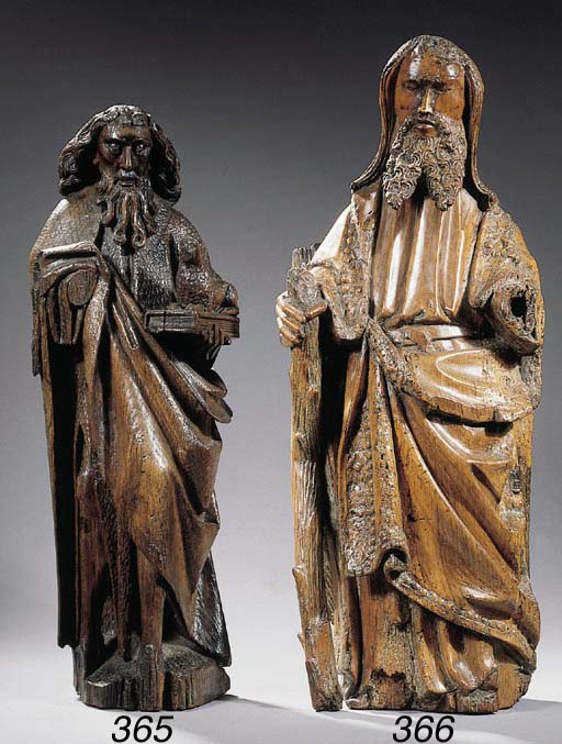 A carved wood figure of St. Jo