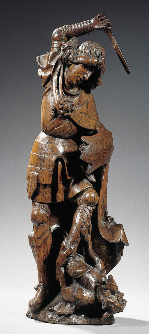 A carved wood figure of St. Mi