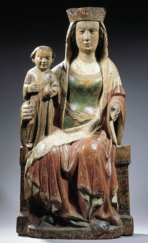 A polychrome carved wood group