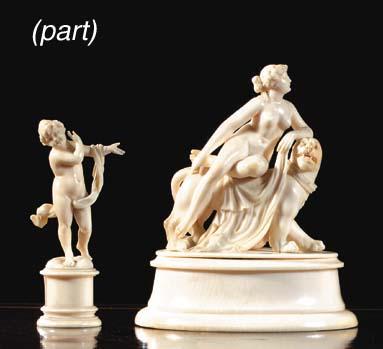 A carved ivory group of a fema