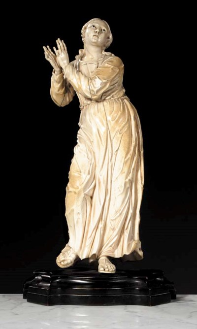 A carved ivory female figure