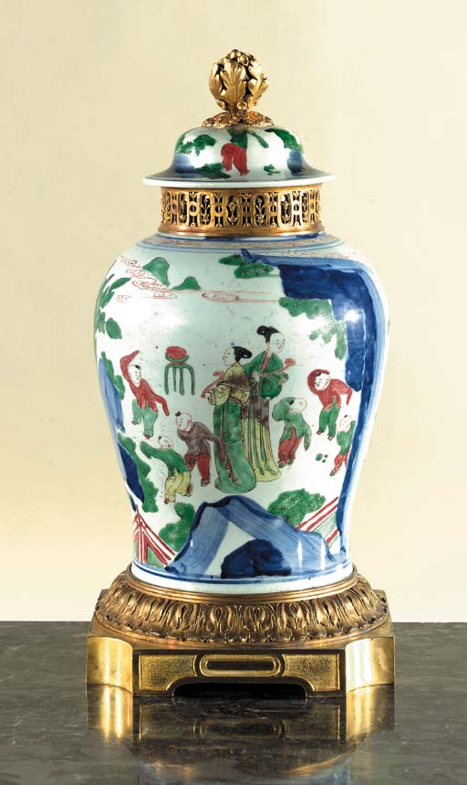 A Chinese Wucai ormolu-mounted baluster vase and cover