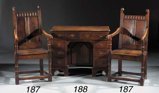 A pair of English oak armchair
