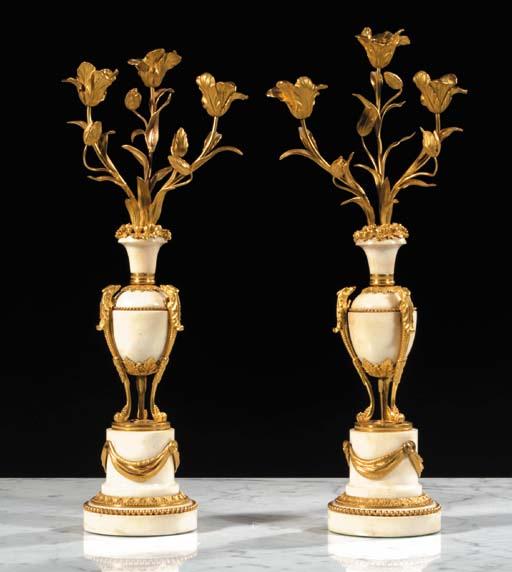 A pair of Louis XVI white marb