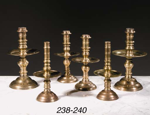 A pair of Dutch colonial brass candlesticks