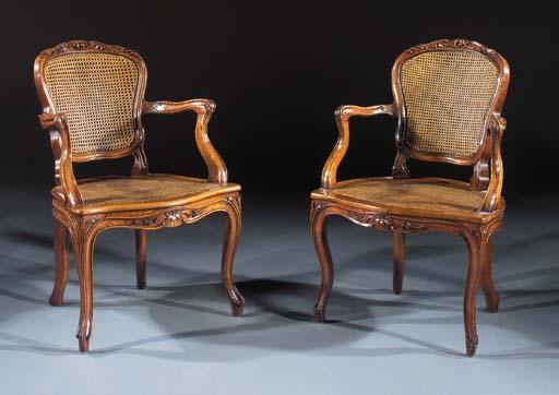 A pair of beechwood fauteuils