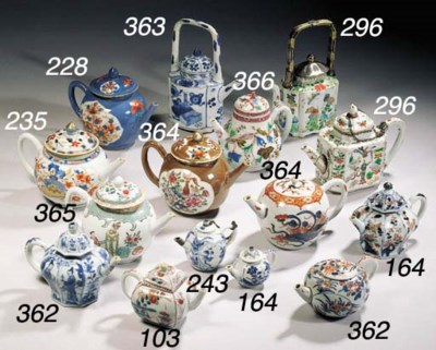 A pair of Imari teapots and co