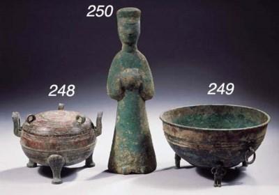 An archaic bronze tripod vesse