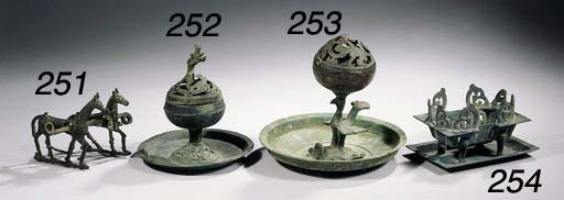 A bronze incense burner, cover
