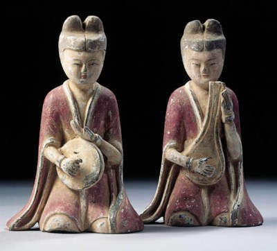 Two grey pottery figures of mu