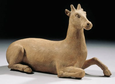 A red pottery figure of a deer