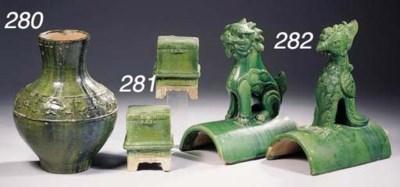 A green-glazed baluster vase,