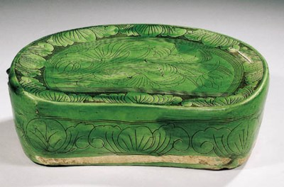 A green-glazed pottery pillow