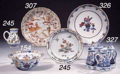 A set of twelve Imari saucer d