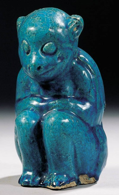 A turquoise-glazed pottery fig