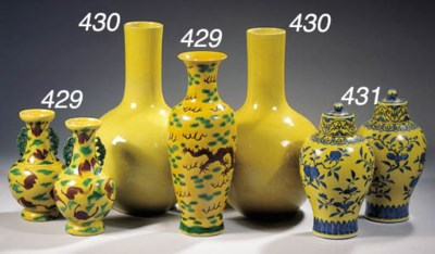 A pair of yellow-glazed bottle