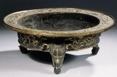 A rare Ming parcel gilt tripod