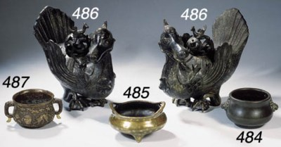 A pair of bronze incense burne