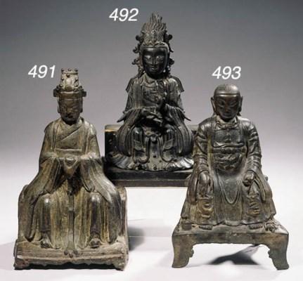 A bronze figure of Xiwang Mu