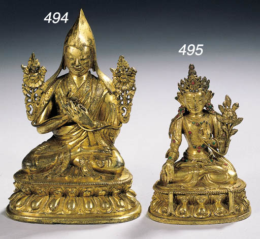 A Sino Tibetan gilt bronze fig