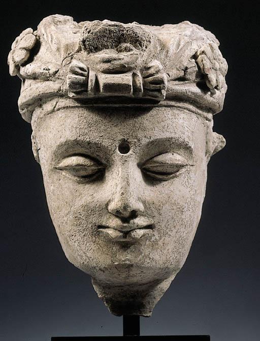 a gandhara stucco head of a bo
