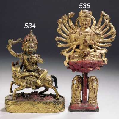 a chinese gilt and red lacquer