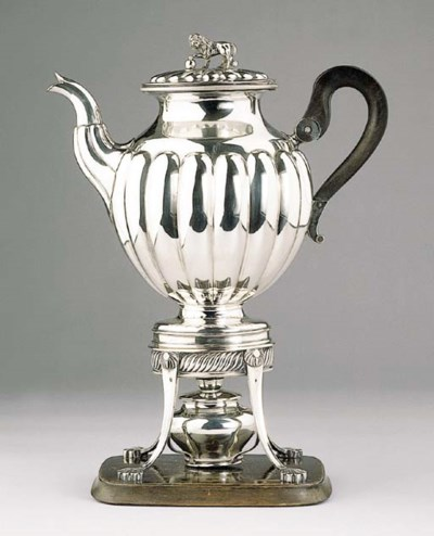 A Dutch silver coffee pot on a