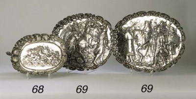 A silver oval bowl and two Chi