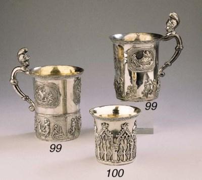 Two Russian silver mugs